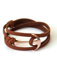 Rose gold anchor bracelet on brown leather