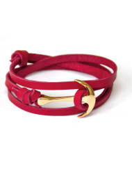 Gold anchor bracelet on red leather
