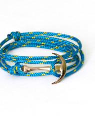 Rose gold anchor bracelet on blue rope
