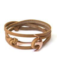 Rose gold anchor on beige leather