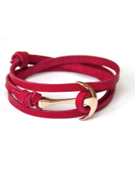 Rose gold anchor on red leather