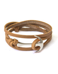 Silver anchor bracelet on beige leather