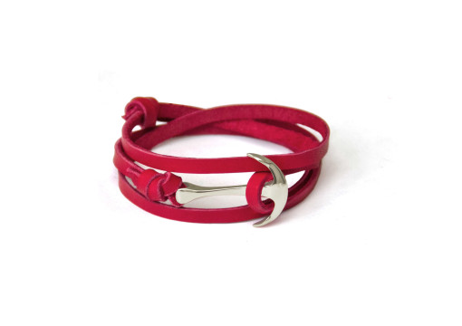 Silver anchor bracelet on red leather