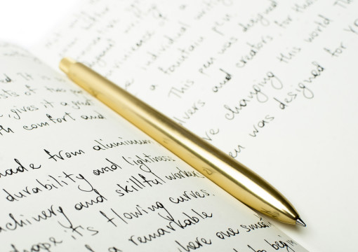 Gold Sens Pen on Notepad